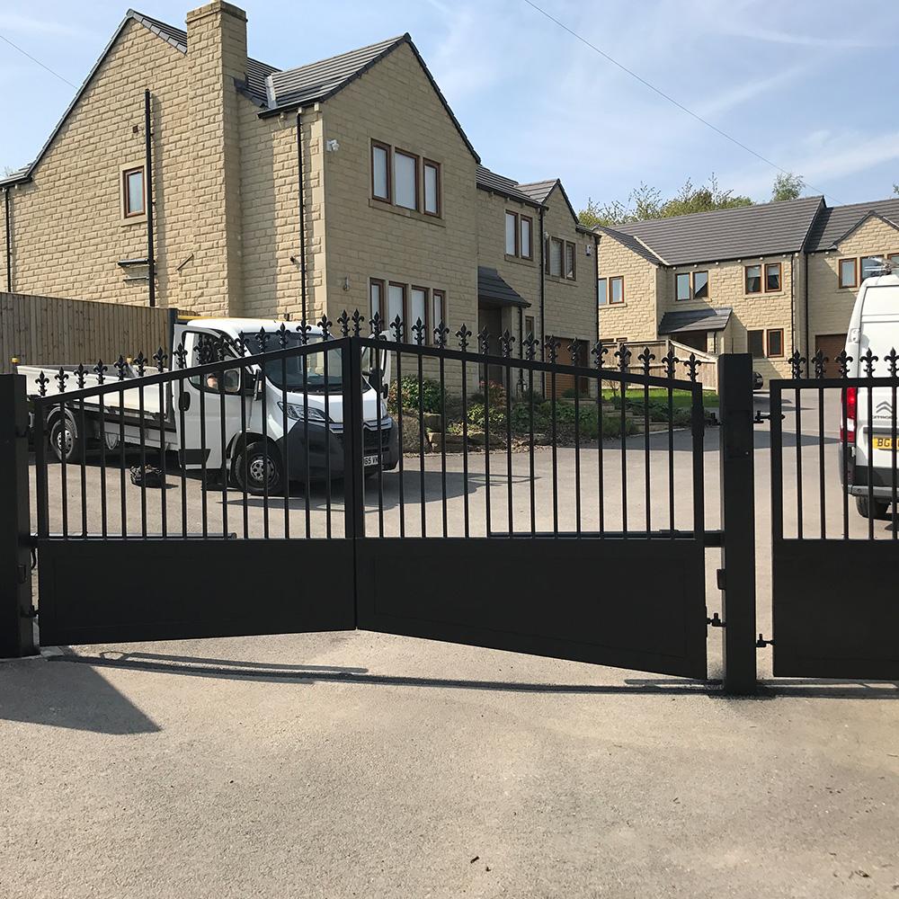 Wrought iron swing gates shaped