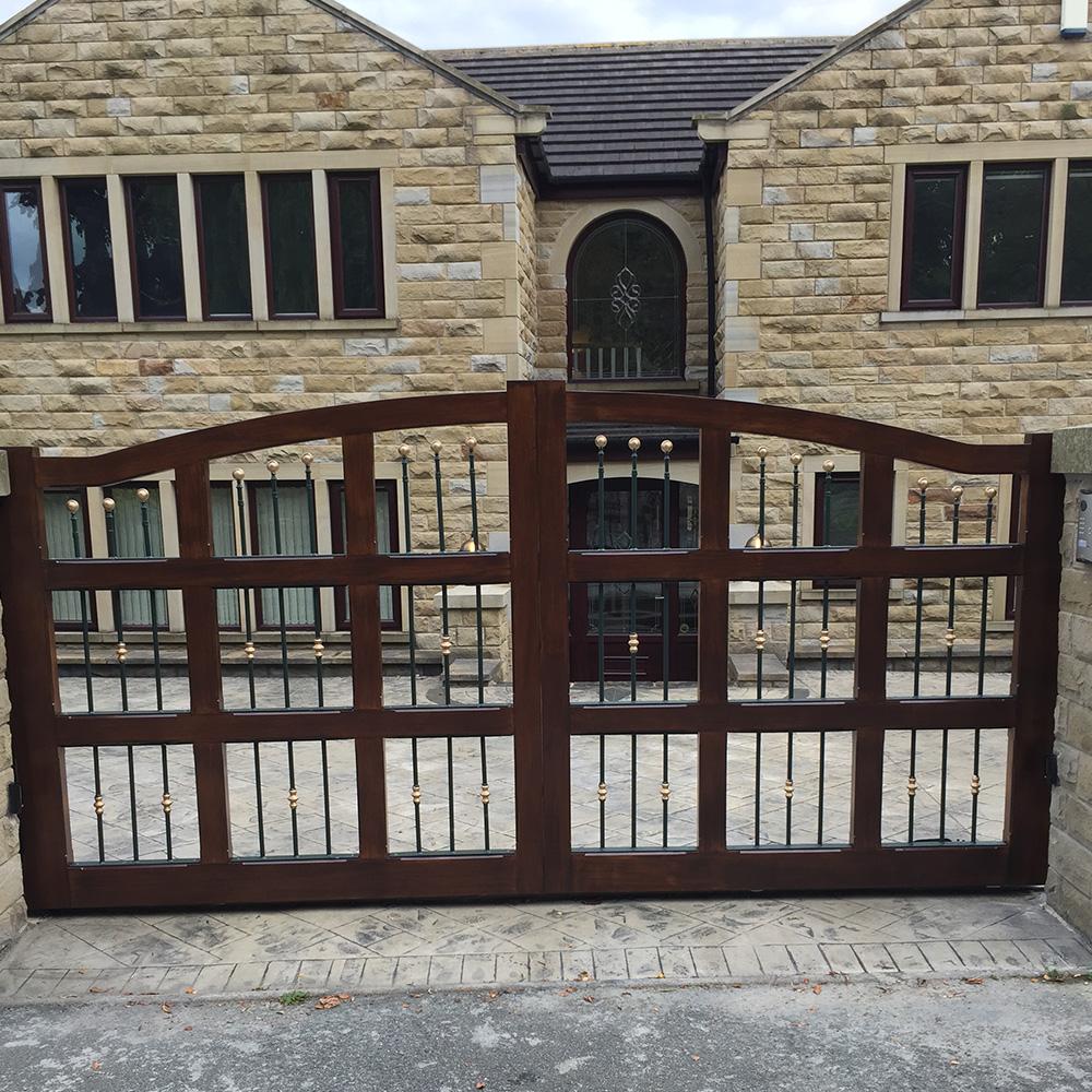 Hard wood track sliding gate