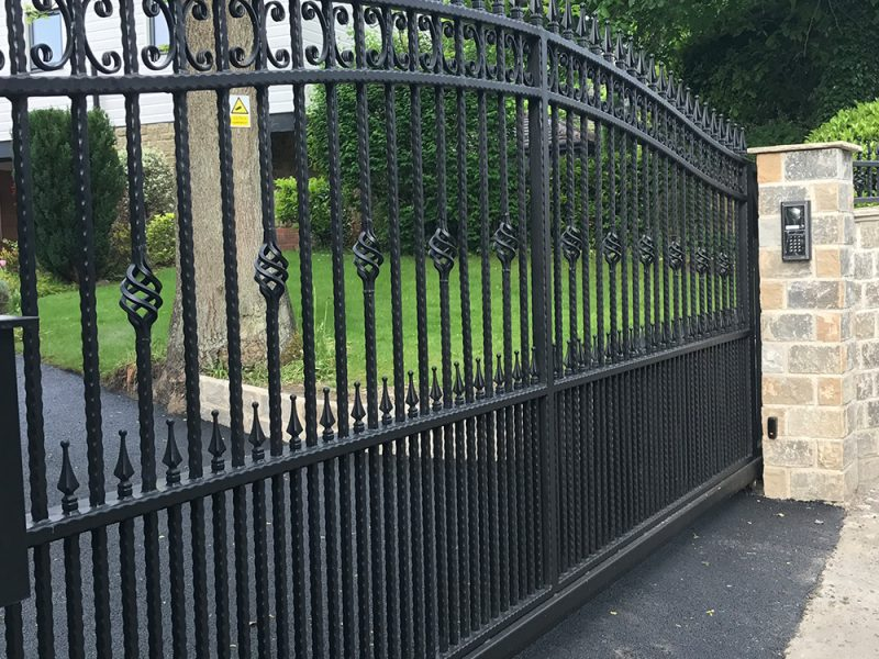 Wrought iron cantilever gate